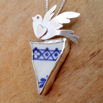Flying bird with heart porcelain delft pendant