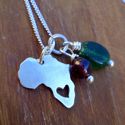 Africa with heart cutout and gemstones