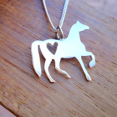 Horse with heart cutout pendant