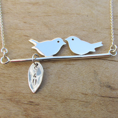 2 birds on a branch with hand stamped leaf