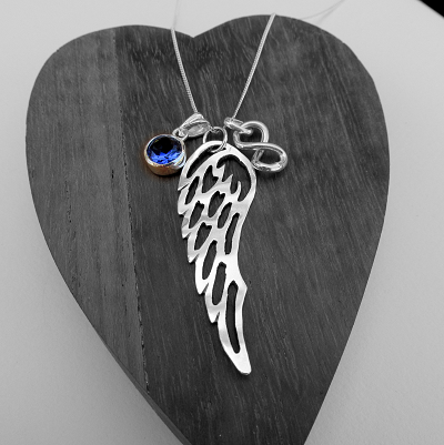 Angel wing with gemstone and infinity sign