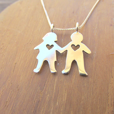 Boy and girl pendant with heart cutout