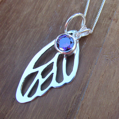 Butterfly wing cutout necklace and gemstone