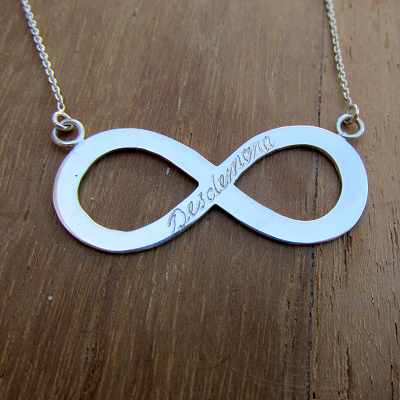 Infinity sign with hand engraving