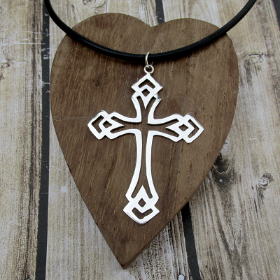 Mans cross pendant on leather