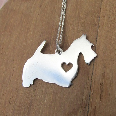 Scotty dog pendant with heart cutout