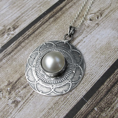 Embossed mandala pendant with mabe pearl