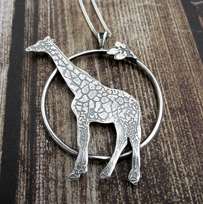 Giraffe embossed necklace in circle