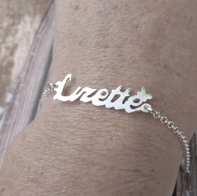 Cutout  sterling silver name bracelet with little butterfly