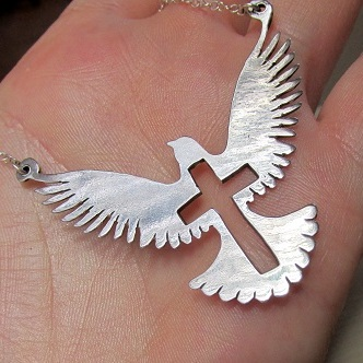 Flying dove with cross cutout